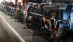 14.10.2015, Bahnhof, Freilassing, GER, Flüchtlingskrise in der EU, im Bild wartende Flüchtlinge am Bahnsteig spiegeln sich in den Fensterscheiben des Sonderzuges // waiting refugees on the platform are reflected in the windows of the special train, Railway Station, Freilassing, Germany on 2015/10/14. EXPA Pictures © 2015, PhotoCredit: EXPA/ JFK