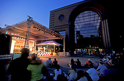 Stock photo of a crowd watching a performance on stage at the International Festival in downtown Houston Texas