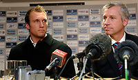 Photo: Daniel Hambury.<br />West Ham United v Fulham. The Barclays Premiership. 23/01/2006.<br />West Ham's new signing Dean Ashton (L) meets the media with his new manager Alan Pardew.