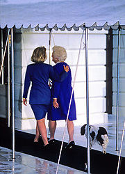 Former first lady Barbara Bush, wife of former President George H.W. Bush and mother of former President George W. Bush, died Tuesday at her home in Houston. She was 92. Barbara Bush had been in failing health, suffering from congestive heart failure and chronic obstructive pulmonary disease. George and Barbara, who celebrated their 73rd wedding anniversary on Jan. 6, hold the record for the longest-married presidential pair. Mrs. Bush was known for her wit and emphasis on family. One of her primary causes was literacy. She founded the Barbara Bush Foundation for Family Literacy in 1989 to carry forth her legacy in the cause for literacy. PICTURED: Nov. 19, 1992 - Washington, District of Columbia, United States of America - First lady BARBARA BUSH and HILLARY RODHAM CLINTON, followed by the Bush family dog Millie, walk to the South Portico the White House in Washington, D.C. after their photo-op together following the election. (Credit Image: © Howard L. Sachs/CNP/ZUMAPRESS.com)