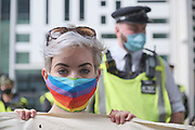 """Protester holds a banner in front of the Home Office at the """"Climate Justice is Migrant Justice"""" protest, outside Home Office, Marsham Street in central London on Friday, Sept 4, 2020. (VXP Photo/ Gio Strondl)"""