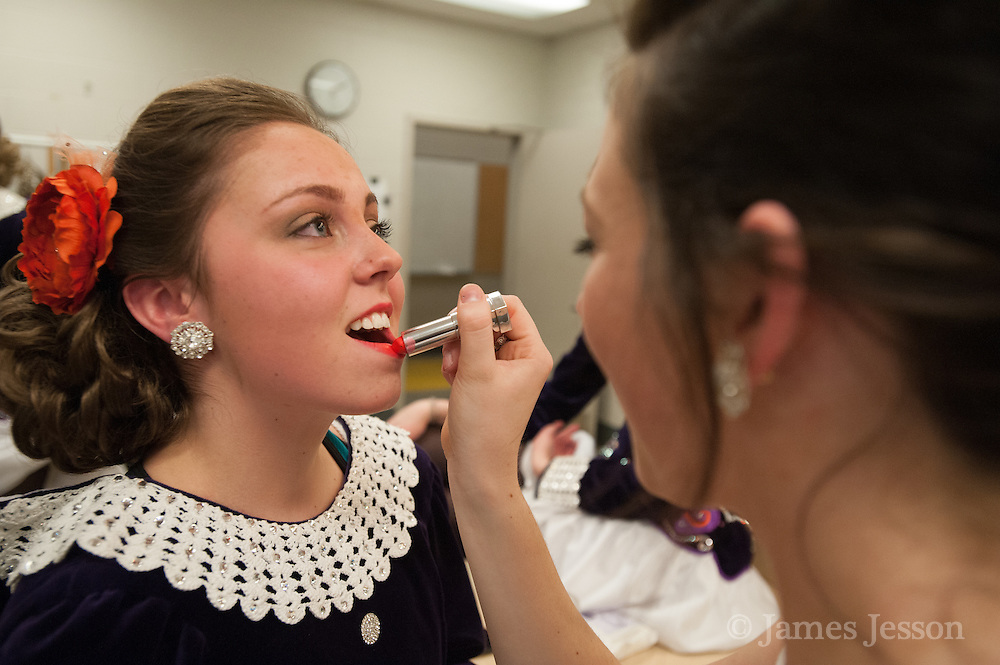 Casey Allen, of Westford, is helped by her friend Erin Wallace, of Chelmsford, in the dressing room during a Worlds Preview Party at Chelmsford High School featuring dancers who have qualified for the Irish Dance World Championships in Montreal, Mar. 21, 2015.   (Wicked Local Photo/James Jesson).