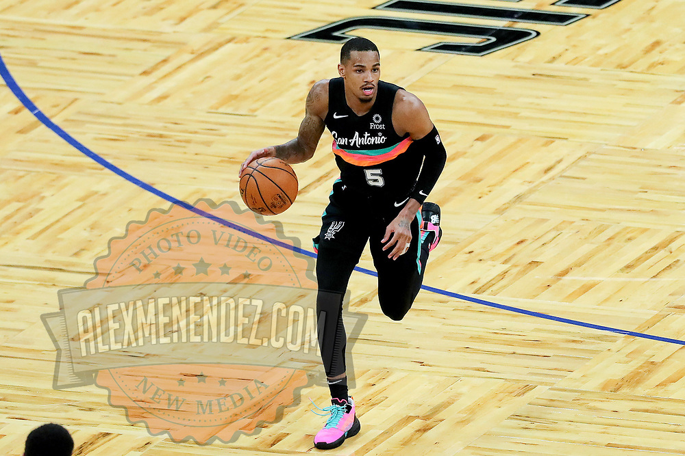 ORLANDO, FL - APRIL 12: Dejounte Murray #5 of the San Antonio Spurs controls the ball against the Orlando Magic at Amway Center on April 12, 2021 in Orlando, Florida. NOTE TO USER: User expressly acknowledges and agrees that, by downloading and or using this photograph, User is consenting to the terms and conditions of the Getty Images License Agreement. (Photo by Alex Menendez/Getty Images)*** Local Caption *** Dejounte Murray