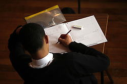Embargoed to 0001 Tuesday June 6 File photo dated 02/03/12 of a teenager taking a exam. Around three in 10 teenage boys admit they have cried because they are stressed out by exams, according to a poll.