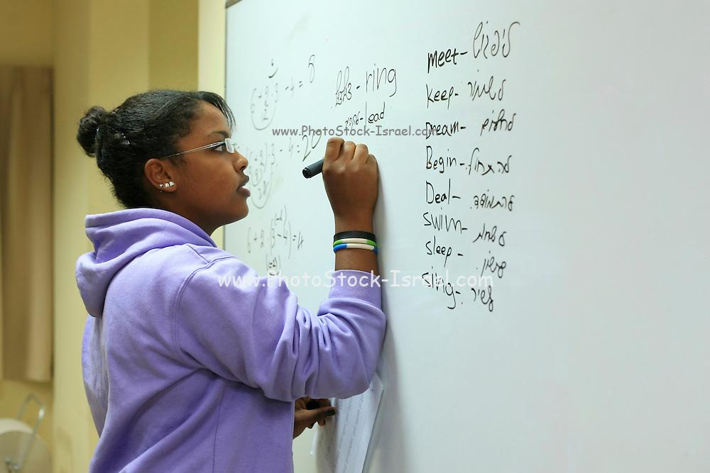 After school hours, parents tutor pupils in a public school in Israel
