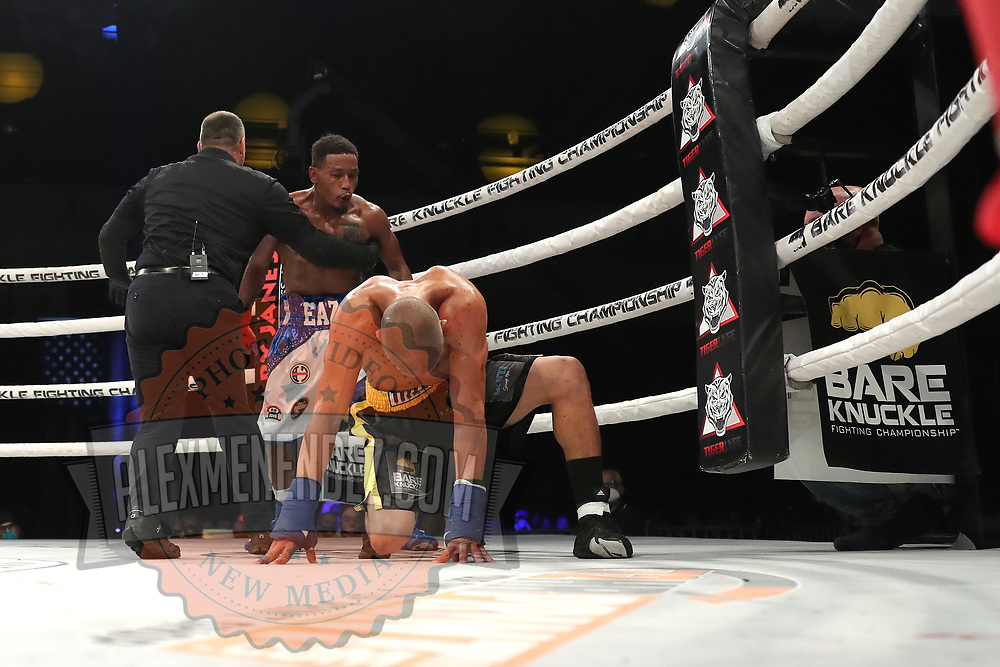 DAYTONA BEACH, FL - SEPTEMBER 11: Abdiel Velazquez gets knocked down by Reggie Barnett during the Bare Knuckle Fighting Championships at the Ocean Center on September 11, 2020 in Daytona Beach, Florida. (Photo by Alex Menendez/Getty Images) *** Local Caption *** Abdiel Velazquez; Reggie Barnett