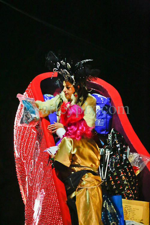 12 Feb 2015. New Orleans, Louisiana.<br /> Mardi Gras. 'Honorary Muse'  Sue Zemanick, executive chef at Gautreau's in the giant shoe as the Krewe of Muses makes its way along Magazine Street.<br /> Photo; Charlie Varley/varleypix.com