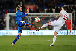 Birkir Bjarnason (Sampdoria) of Iceland jostles for the ball with Samuel Ricketts of Wales (wolves) - Photo mandatory by-line: Dougie Allward/JMP - Tel: Mobile: 07966 386802 03/03/2014 -