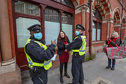 A member of the public is being detained from the Police after an anti-lockdown protest was announced to be held at the Kings Cross station in London, on Saturday, Nov 28, 2020. Some of the members of the public were challenged by the police after seen not wearing face masks, some of them were detained and arrested. (Photo/ Vudi Xhymshiti)