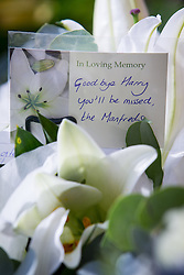 """© Licensed to London News Pictures . 14/10/2013 . Gorton Monastery , Manchester , UK . Tributes and flowers from the Manfreds . The Humanist funeral of photographer Harry Goodwin , attended by footballers and other celibrities and featuring music by artists he had photographed including """"He Ain't Heavy, He's My Brother"""" by the Hollies and """" Happiness """" by Ken Dodd . Photo credit : Joel Goodman/LNP"""