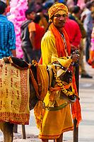 Indian man smoking a bidi (Clove cigarette), Holi (festival of colors), Mathura, Uttar Pradesh, India.