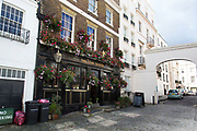 The Star Tavern pub In Belgravia London, United Kingdom. Belgravia is a district in West London in the City of Westminster and the Royal Borough of Kensington and Chelsea. It is noted for its very expensive residential properties and is one of the wealthiest districts in the world. Much of it, known as the Grosvenor Estate, is still owned by a family property company, the Duke of Westminsters Grosvenor Group.