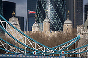 Weeks before the UKs Brexit from the European Union 31st January 2020, the British Union Jack flag flies over the Norman-era Tower of London and the northern steel suspension chains and hangers of Tower Bridge, on 17th January 2020, in London, England.