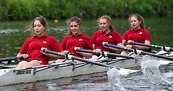 © Licensed to London News Pictures.13/06/15<br /> Durham, England<br /> <br /> A woman's crew take part in the racing during the 182nd Durham Regatta rowing event held on the River Wear. The origins of the regatta date back  to commemorations marking victory at the Battle of Waterloo in 1815. This is the second oldest event of this type in the country and attracts over 2000 competitors from across the country.<br /> <br /> Photo credit : Ian Forsyth/LNP