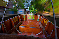 DAMNOEN SADUAK, THAILAND - CIRCA SEPTEMBER 2014: Motorboat navigating a canal close the famous floating market of Damnoen Saduak in the central region of Thailand.