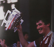 Conor Hayes receives the McCarthy Cup for the second year in a row.