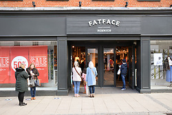 As England eases out of Coronavirus lockdown no 3, non-essential shops reopen on 12 April 2021. Queueing to get into Fatface Norwich UK
