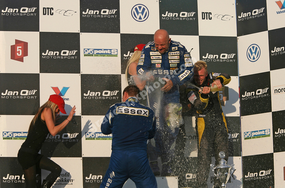 Team Essex BMW drivers Casper Elgaard and John Nielsen and Tom Pedersen celebrate with champagne on the podium after the 2007 DTC finals at Jyllands-Ringen. Photo: Grand Prix Photo