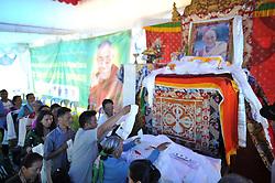 July 6, 2018 - Kathmandu, NP, Nepal - Tibetan people offering rituals towards the poster of Dalai Lama during 83rd birthday celebration of the exiled spiritual leader the Dalai Lama in Lalitpur, Nepal on Friday, July 06, 2018. (Credit Image: © Narayan Maharjan/NurPhoto via ZUMA Press)