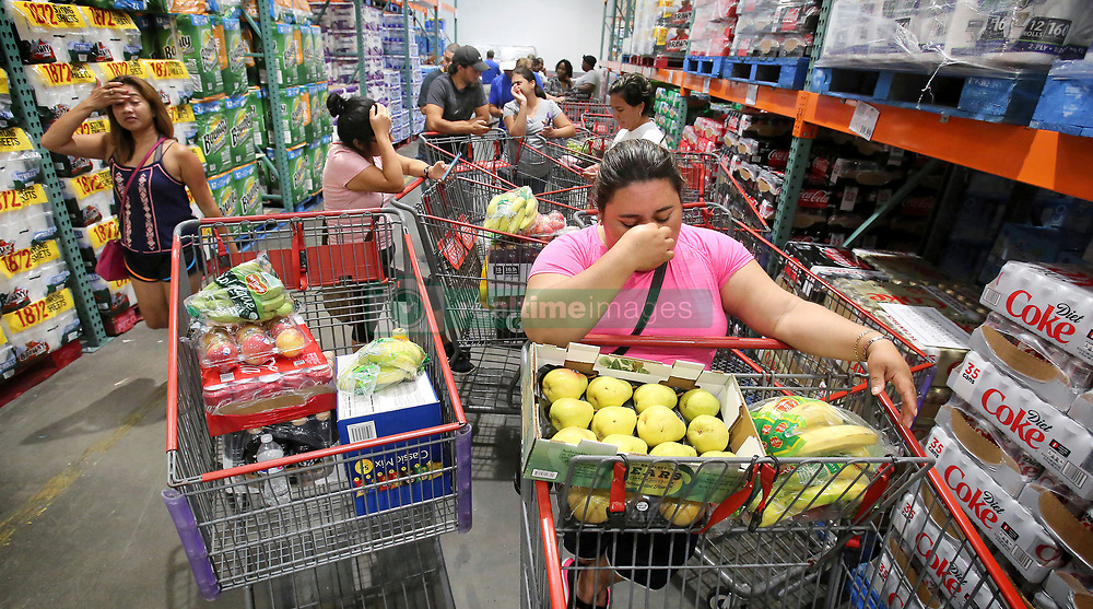 September 6, 2017 - Altamonte Springs, FL, USA - Shoppers at Costco in Altamonte Springs, Fla., wait in line for the arrival of a shipment of water during preparations for the impending arrival of Hurricane Irma on Wednesday, Sept. 6, 2017. These residents waited in line starting at 7 a.m. for an 11 a.m. water delivery. (Credit Image: © Joe Burbank/TNS via ZUMA Wire)