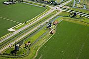 Nederland, Noord-Holland, Schermerhorn, 14-07-2008; molengang aan de Noordervaart: in verband met het niveauverschil tussen de polder Schermer (voorgrond) en de boezem (diagonaal rechtboven) zijn drie opeenvolgende molens nodig om het water vanuit de polder uit te slaan; de bijnamen van de molens zijn (van boven naar beneden) de waker, de slaper, de dromer, in de achtergrond Eilandspolder; Gouden Eeuw, Schermerpolder, poldermolen, museummolen, toerisme, attractie, toeristische attractie. .luchtfoto (toeslag); aerial photo (additional fee required); .foto Siebe Swart / photo Siebe Swart