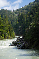 The Jedediah Smith River courses through the Siskiyou Mountains with a high springtime flow in Northern California.