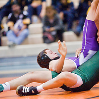 120812       Cable Hoover<br /> <br /> Miyamura Patriot AJ Starkovich rolls over Wingate Bear Alvin Grieve during the Gallup Duals wrestling meet at Chief Manuelito Middle School in Gallup Saturday.