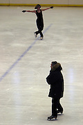 Moscow, Russia, 23/02/2004..AZLK Moskvich chief coach Viktor Kudriatsev training skaters on the club's main ice rink..