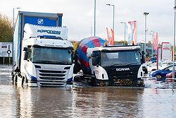 South Yorkshire flooding. Ickles Roundabout Rotherham. As Specialist rescue teams from the West Midlands Fire service rescue people from vehicles and business premises along the A6178 Sheffield Rd a Scania lorry tries to make its way through flood water which in places is up to chest deep past stranded fellow articulated lorry driver<br /> <br />  Copyright Paul David Drabble<br />  07 November 2019<br />  www.pauldaviddrabble.co.uk