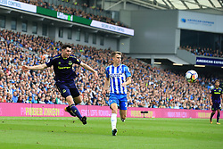 15 October 2017 -  Premier League - Brighton and Hove Albion v Everton - Michael Keane of Everton crosses the ball as Solly March of Brighton and Hove Albion looks on - Photo: Marc Atkins/Offside