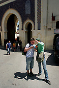 A couple take a moment to check their guide book before entering the confusing and bustling Fes el-Bali in Fes, Morocco on Tuesday, May 29, 2007. Fes el-Bali contains several thousand alleys and endless opportunities to shop and eat. (PHOTO BY TIMOTHY D. BURDICK)