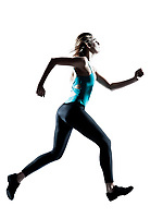 Side view of a young sporty woman jogging isolated on white background