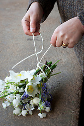 Showing how to knot hand tied bunch with string
