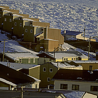 BAFFIN ISLAND, Canada. Government-built housing in Iqaluit (formerly Frobisher Bay), capital of Nunavut Territory, beside frozen Frobisher Bay.