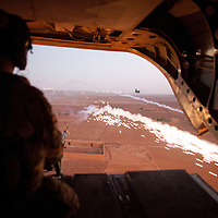 A CH-47 Chinook helicopter deploys chaff to counter any heat seaking ground fire as it prepares to deploy troops as part of Operation Tora Pishaw 5 in Nad e Ali North, Helmand Province, Afghanistan on the 11th of November 2011.