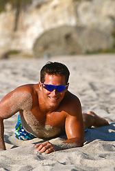 Man in sunglasses lying on the beach