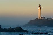 Waves and coastal rocks at Pigeon Point Lighthouse at sunrise, San Mateo County coast, California