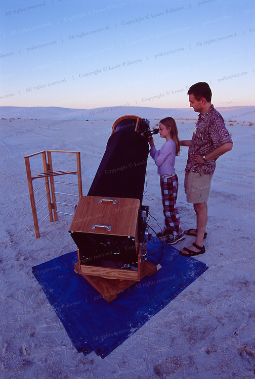 """14 1/2""""  Beautifully hand made wooden Dobsonian telescope made from a kit called a Starmaster was made by Ed Juddo.  His daughter Roey is looking through the scope.  <br /> 9920 Modesto NE., Albuquerque, NM 87122"""
