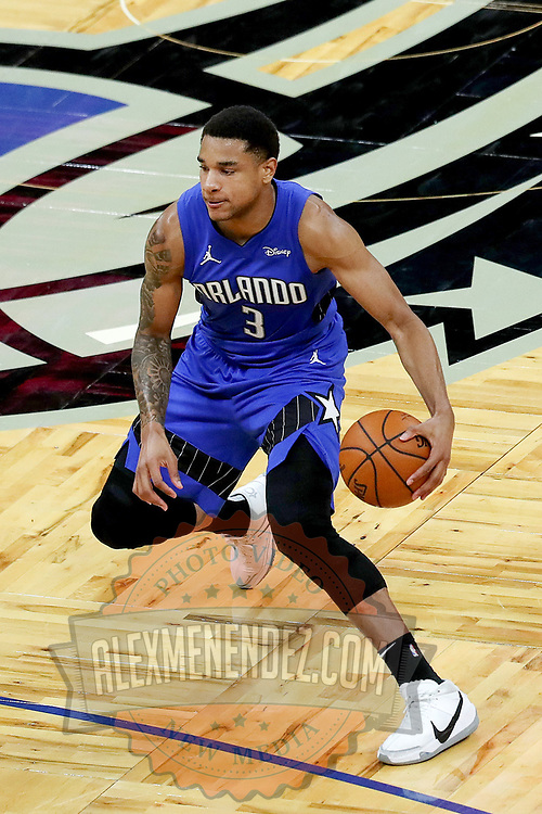 ORLANDO, FL - APRIL 18: Chuma Okeke #3 of the Orlando Magic controls the ball against the Houston Rockets at Amway Center on April 18, 2021 in Orlando, Florida. NOTE TO USER: User expressly acknowledges and agrees that, by downloading and or using this photograph, User is consenting to the terms and conditions of the Getty Images License Agreement. (Photo by Alex Menendez/Getty Images)*** Local Caption ***  Chuma Okeke