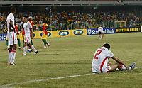 Photo: Steve Bond/Richard Lane Photography.<br />Guinea v Morocco. Africa Cup of Nations. 24/01/2008. Michael Basser (seated) looks dejected after he gives away a penalty