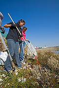 Cleaning up the Dominguez Channel at Artesia Transit Center. Over 14,000 volunteers took part in Coastal Cleanup Day in Los Angeles County, cleaning up beaches, parks, alleys, creeks, highways and storm drains at 69 different sites. Los Angeles, California, USA