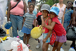28th August, 2005. New Orleans, Louisiana. Jamaica Milton (rt) hugs her sister Jakia for comfort as they wait in line with thousands of people to seek safety in the Superdome.