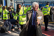 Air passengers find their way through environmental activists protesting about Climate Change during the occupation of City Airport Londons Business Travel hub in east London, the fourth day of a two-week prolonged worldwide protest by members of Extinction Rebellion, on 10th October 2019, in London, England.