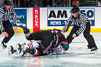 KELOWNA, CANADA - OCTOBER 20: Brad Ginnell #27 of the Portland Winterhawks drops the gloves with Erik Gardiner #12 of the Kelowna Rockets on October 20, 2017 at Prospera Place in Kelowna, British Columbia, Canada.  (Photo by Marissa Baecker/Shoot the Breeze)  *** Local Caption ***