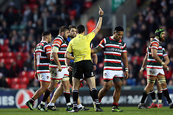 Referee Pascal Gauzere shows Leicester Tigers Manu Tuilagi the yellow card during the European Champions Cup, pool one match at Welford Road, Leicester.