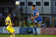 Karleigh Osborne of AFC Wimbledon jumps to head the ball. Skybet football league two play off semi final, 1st leg match, AFC Wimbledon v Accrington Stanley at the Cherry Red Records Stadium in Kingston upon Thames, Surrey on Saturday 14th May 2016.<br /> pic by John Patrick Fletcher, Andrew Orchard sports photography.
