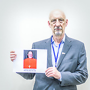 2018<br /> Peter Isley, a survivor and an activist from Milwaukee, poses for a portrait showing a picture of the Cardinal Timothy Dolen who, when he was archbishop of Milwaukee, moved 65 million dollars with the permission of the Vatican into an illegal trust to avoid compensating victims of clergy sexual abuses in US court. © Simone Padovani