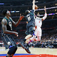 16 December 2015: Los Angeles Clippers guard Chris Paul (3) goes for the acrobatic jump shot over Milwaukee Bucks guard Tyler Ennis (11) during the Los Angeles Clippers 103-90 victory over the Milwaukee Bucks, at the Staples Center, Los Angeles, California, USA.