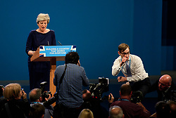 © Licensed to London News Pictures. 04/10/2017. Manchester, UK. A protestor gives the thumbs up to Boris Johnson during a speech by British prime minister THERESA MAY on the final day of the Conservative Party Conference. The four day event is expected to focus heavily on Brexit, with the British prime minister hoping to dampen rumours of a leadership challenge. Photo credit: Ben Cawthra/LNP