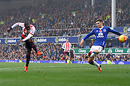Jermain Defoe of Sunderland (l) shoots and scores his teams 1st goal. Barclays Premier League match, Everton v Sunderland at Goodison Park in Liverpool on Sunday 1st November 2015.<br /> pic by Chris Stading, Andrew Orchard sports photography.